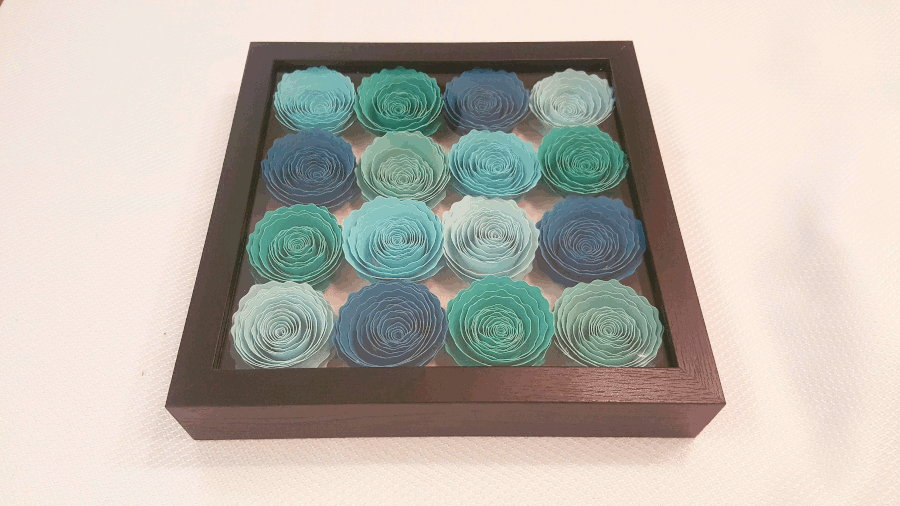 completed rolled flower shadowbox with blue flowers