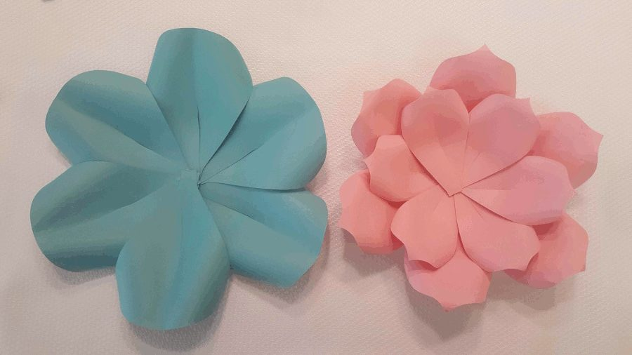 image showing a pink flower with two petal layers finished and blue flower with one petal layer