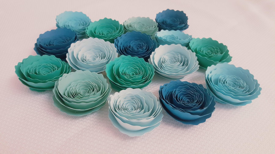 cluster of finished blue rolled paper flowers