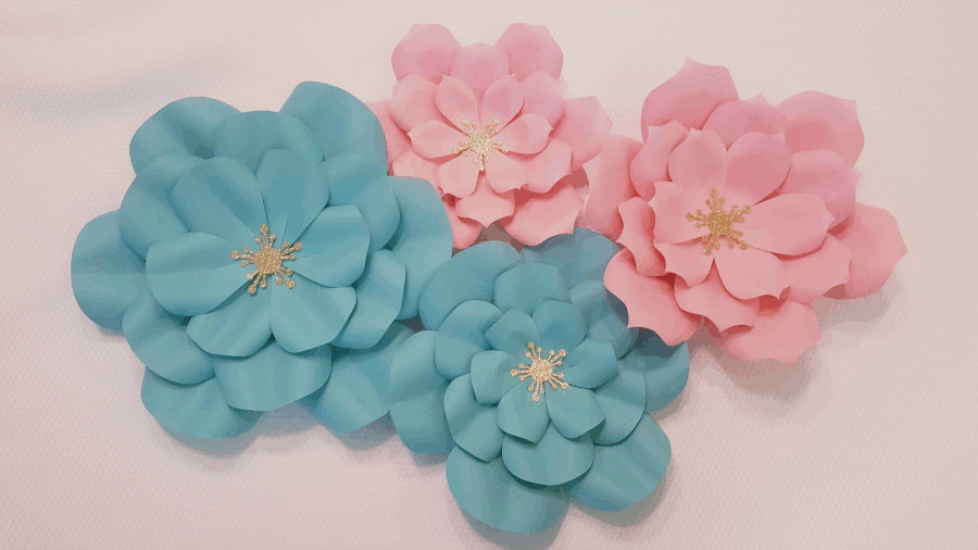 four completed flowers, two pink and two blue